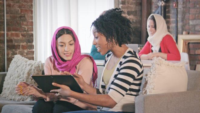 I Stock 821928326 Stock Image Multi Ethnic Female Professionals Interact W Digital Tablet